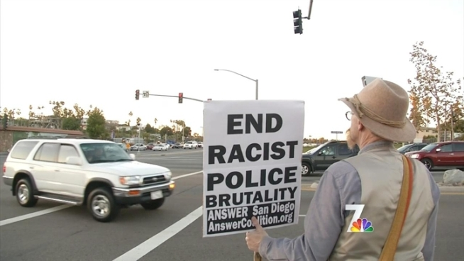 More than 50 people in the North County Coalition of Concerned Citizens, waved signs  and chanted to protest the beating of a man with Down's Syndrome.