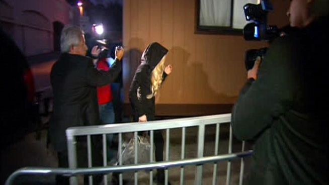 Wearing a hoodie, Lohan showed up before 6am for her community service at the morgue.