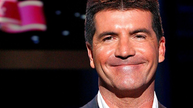 Simon Cowell chats after an advance screening of