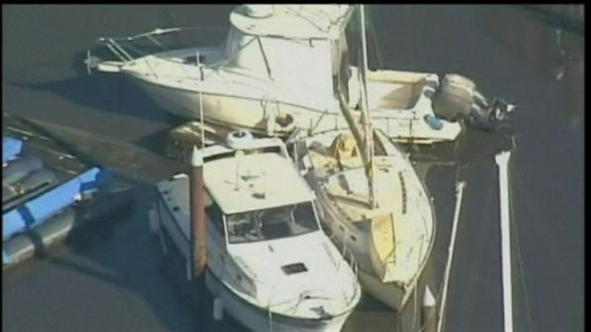 Dozens of boats were damaged Friday as the tsunami struck <a title=