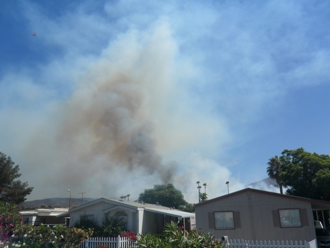 Flames came within yards of dozens of homes in <a title=