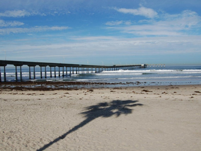 Body, Injured Man Both Found Near Pier