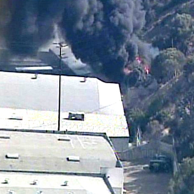 Black Smoke Pours From Industrial Fire