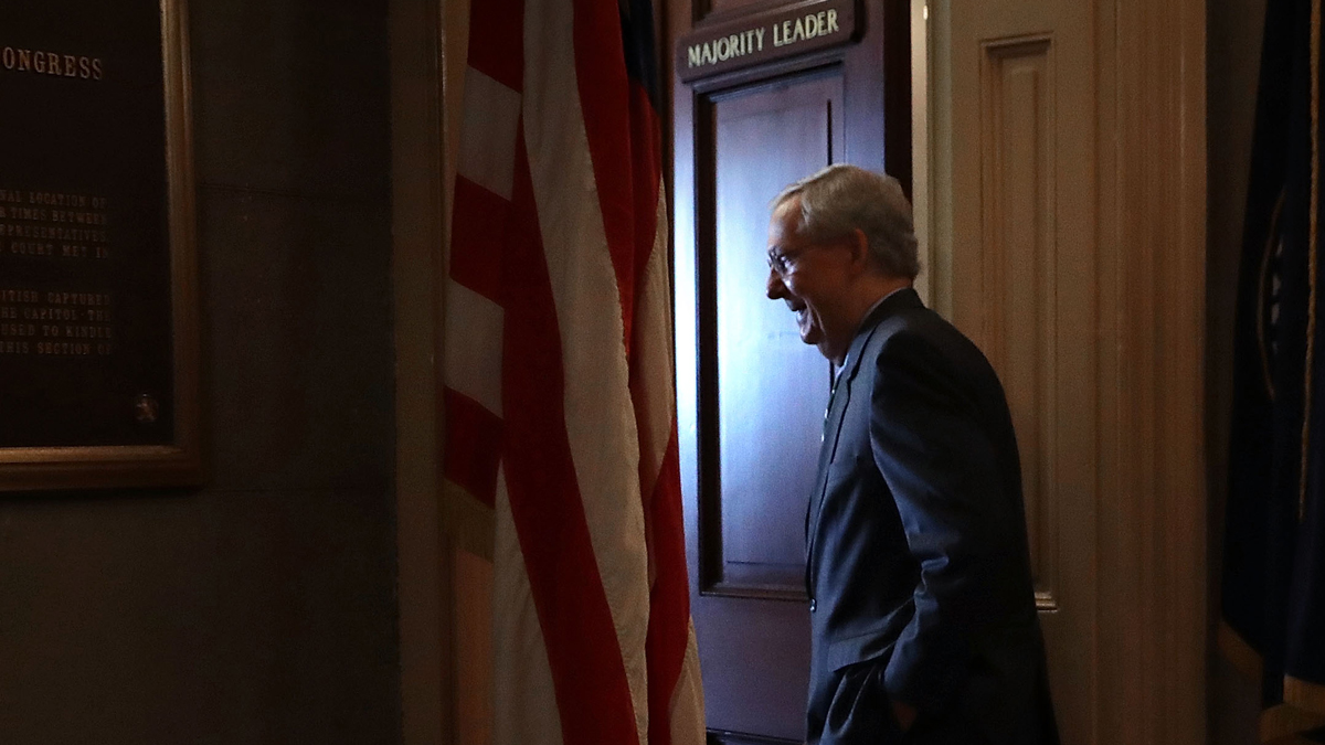 Senate Majority Leader Mitch McConnell, R-Ky., arrives in his office in the U.S. Capitol Thursday, June 22, 2017, in Washington, D.C.