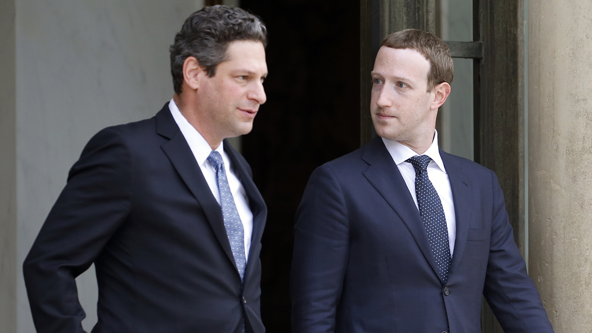 This May 23, 2018, file photo, Facebook Vice President of global public policy Joel Kaplan and Facebook CEO Mark Zuckerberg leave the French presidential palace in Paris after a meeting with President Emmanuel Macron.