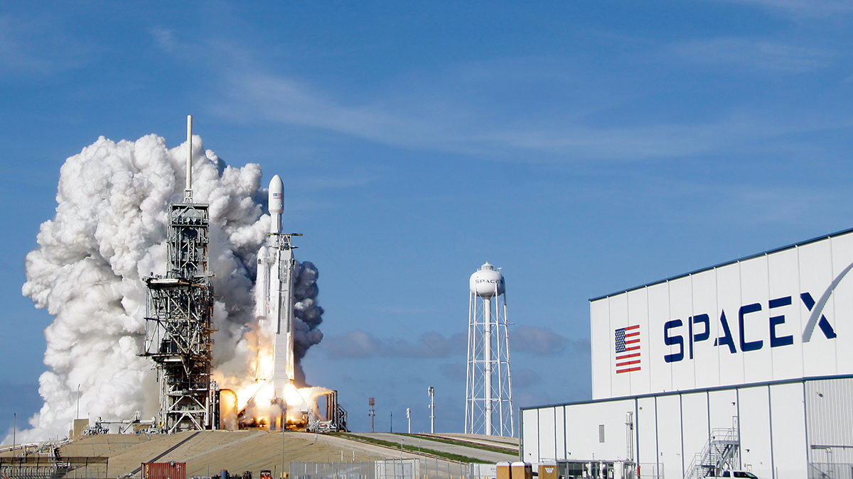 This Feb. 6, 2018, file photo shows a Falcon 9 SpaceX heavy rocket lifting off from pad 39A at the Kennedy Space Center in Cape Canaveral, Fla.
