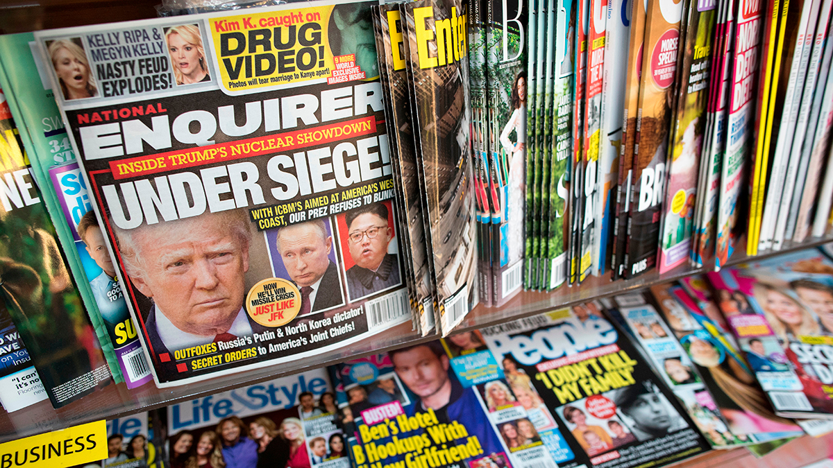 This July 12, 2017, file photo shows the cover of an issue of the National Enquirer featuring President Donald Trump at a store in New York.