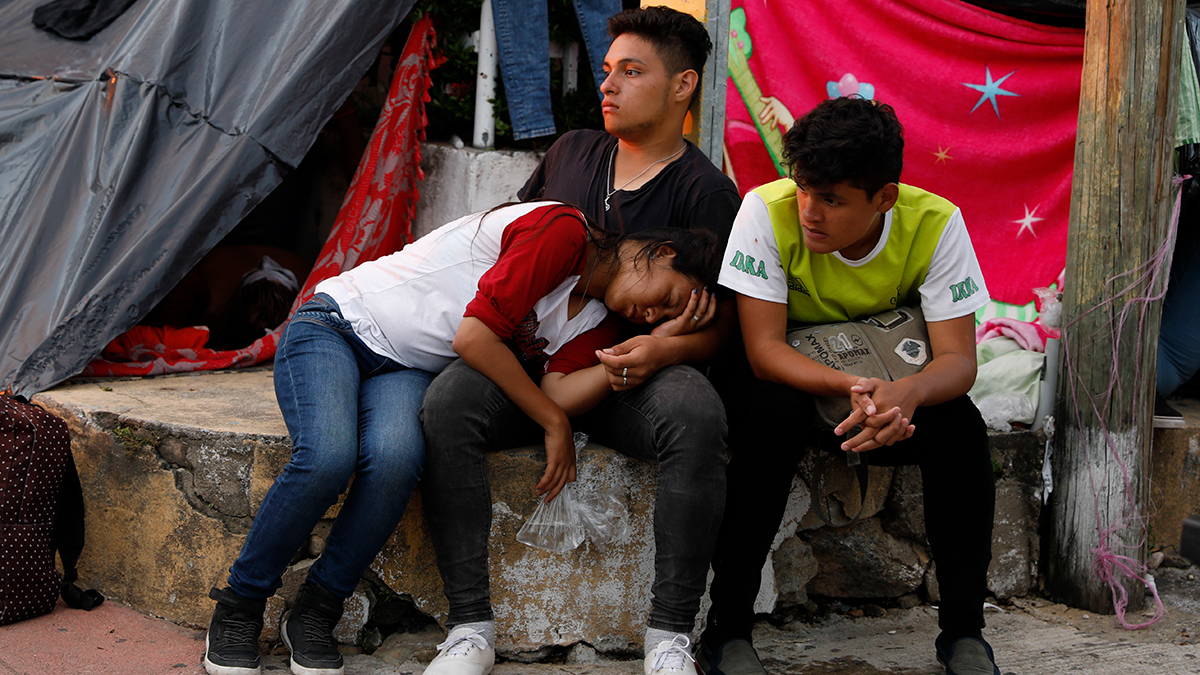 File - Central American migrants rest as a thousands-strong caravan slowly making its way toward the U.S. border stops for the night in Pijijiapan, Chiapas state, Mexico, Thursday, Oct. 25, 2018.
