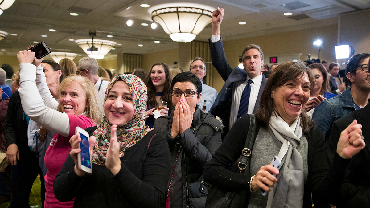 Supporters cheer as they watch returns at an election night party for Democrat congressional candidate Jennifer Wexton, Tuesday, Nov. 6, 2018, in Dulles, Va.