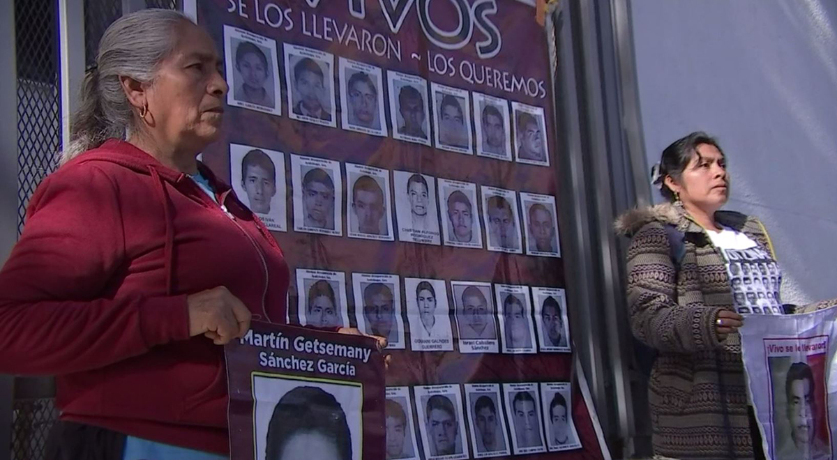 Mothers of two of the 43 disappeared students in Ayotzinapa, Mexico stand in front of the General Consulate of Mexico in Los Angeles.