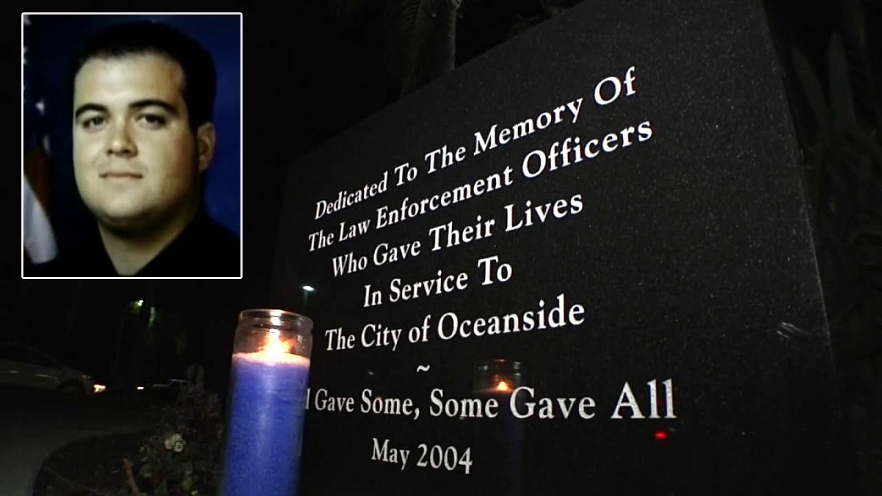 A candle was lighted in honor of slain Officer Dan Bessant.