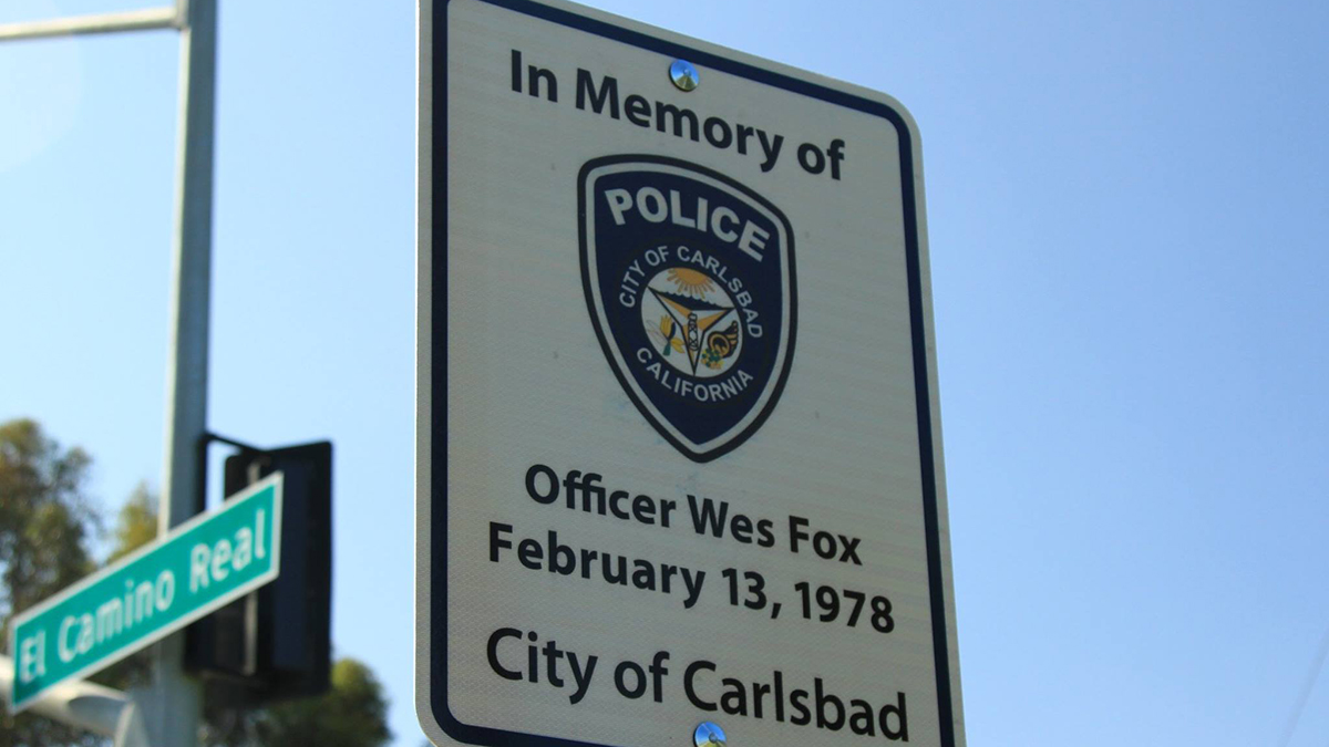 Officer Wesley Fox's sign can be found on El Camino Real at Chestnut Avenue, while Officer Billy Jack's sign stands at Faraday Avenue at El Camino Real.