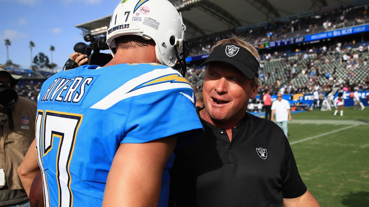 Philip Rivers #17 of the Los Angeles Chargers talks with head coach Jon Gruden of the Oakland Raiders after a game at StubHub Center on October 7, 2018 in Carson, California. The Los Angeles Chargers defeated the Oakland Raiders 26-10. (Photo by Sean M. Haffey/Getty Images)