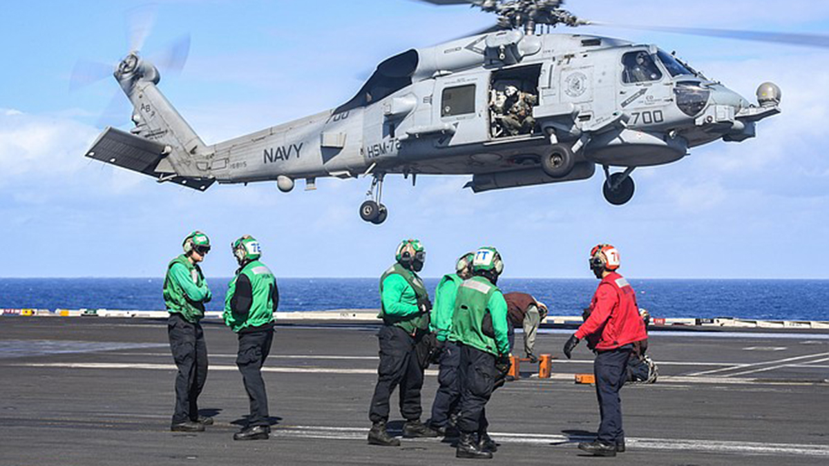 A Sea Hawk helicopter prepares to land on the deck of the aircraft carrier USS Harry S. Truman in the Atlantic Ocean in November.