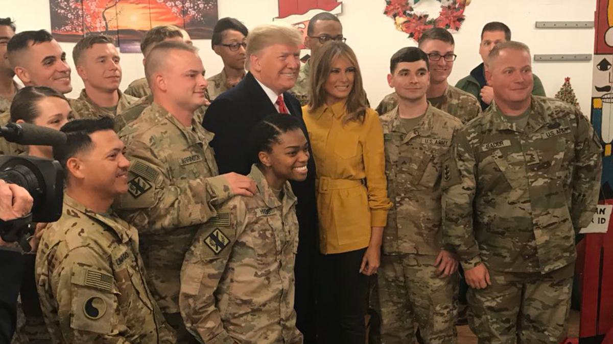 President Donald Trump and first lady Melania Trump visit soldiers on Christmas night, as seen in a photo released by the press secretary, on Dec. 25, 2018.