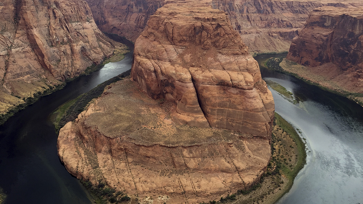 This Aug. 27, 2016, photo shows Horseshoe Bend near Page, Ariz. Authorities say a California girl visiting the Arizona landmark died there from what appears to be an accidental fall.