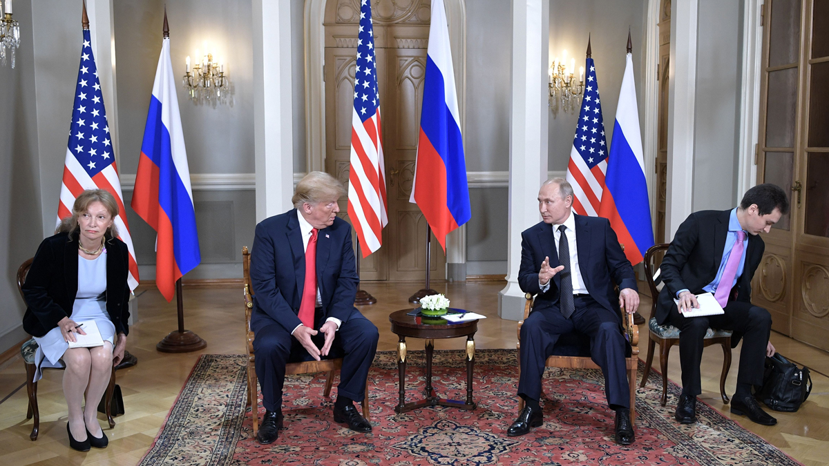 US President Donald Trump (2L) and Russia's President Vladimir Putin wait ahead a meeting in Helsinki, on July 16, 2018. The US and Russian leaders opened an historic summit in Helsinki, with Donald Trump promising an
