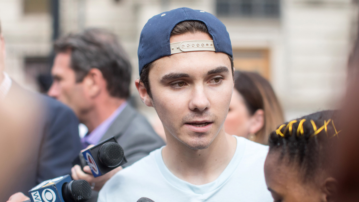 WORCESTER, MA - AUGUST 23: David Hogg, Parkland shooting survivor and activist givess an interview before the kick off of the 50 Miles More walk against gun violence which will end with a protest at Smith and Wesson Firearms factory on August 23, 2018 in Worcester, Massachusetts. 50 Miles More was organized to engage young people in the effort to bring about gun reform legislation. (Photo by Scott Eisen/Getty Images)