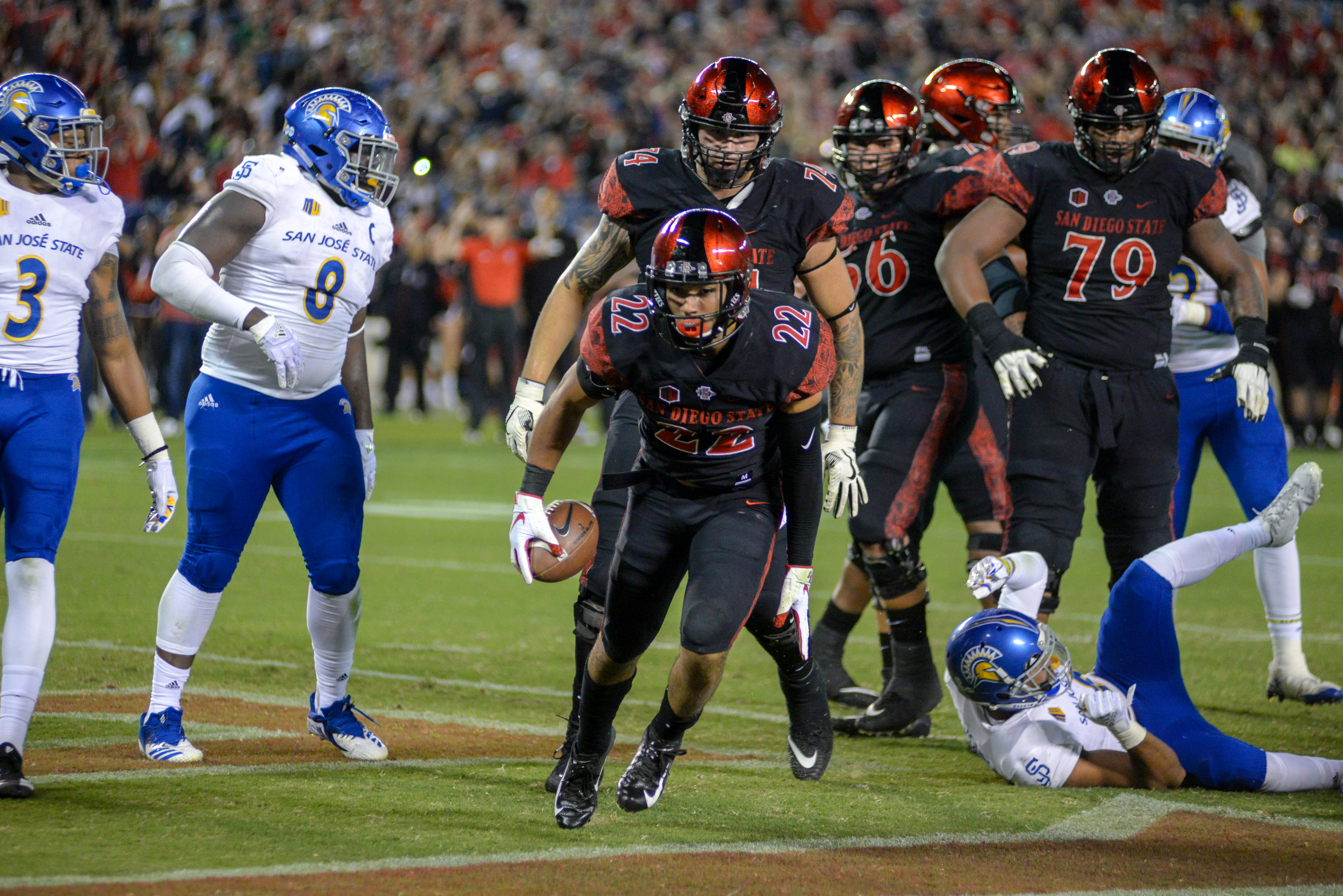 Chase Jasmin #22 of the San Diego State Aztecs celebrates after scoring a touchdown in the first half against the San Jose State Spartans at SDCCU Stadium on October 20, 2018 in San Diego, California. (Photo by Kent Horner/Getty Images)