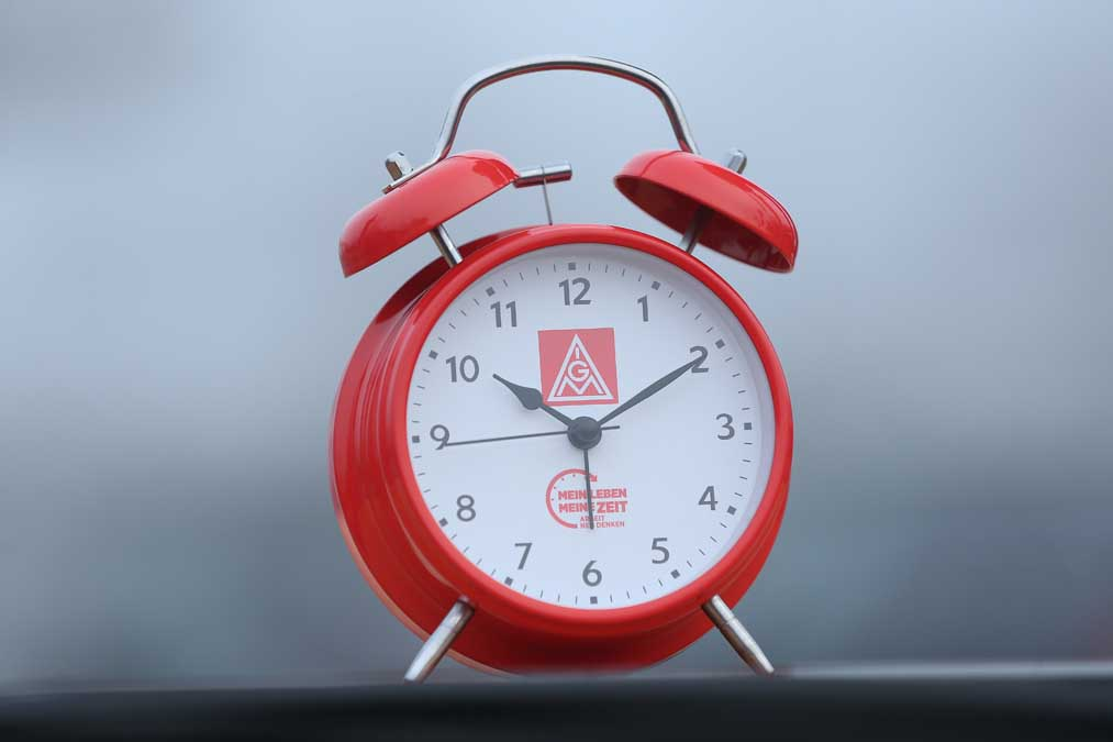 BERLIN, GERMANY - JANUARY 10: An alarm clock meant to symbolize the demand for workers to better determine their working hours stands near where workers from nearby Daimler and General Electric production plants were participating in a strike in demands for better pay and more flexible working conditions on January 10, 2018 in Berlin, Germany. The strike is part of dozens nationwide organized by the IG Metall labour union, which is pressing employers for a 6% increase in wages and the option of a limited, two-year 28 hour work week for workers in particular circumstances. Employers counter the demands would require them to hire at least 150,000 more workers at a time when the German manufacturing sector is already struggling to find qualified workers amidst low unemployment. IG Metall is the world's largest labour union and has 3.9 million members. (Photo by Sean Gallup/Getty Images)