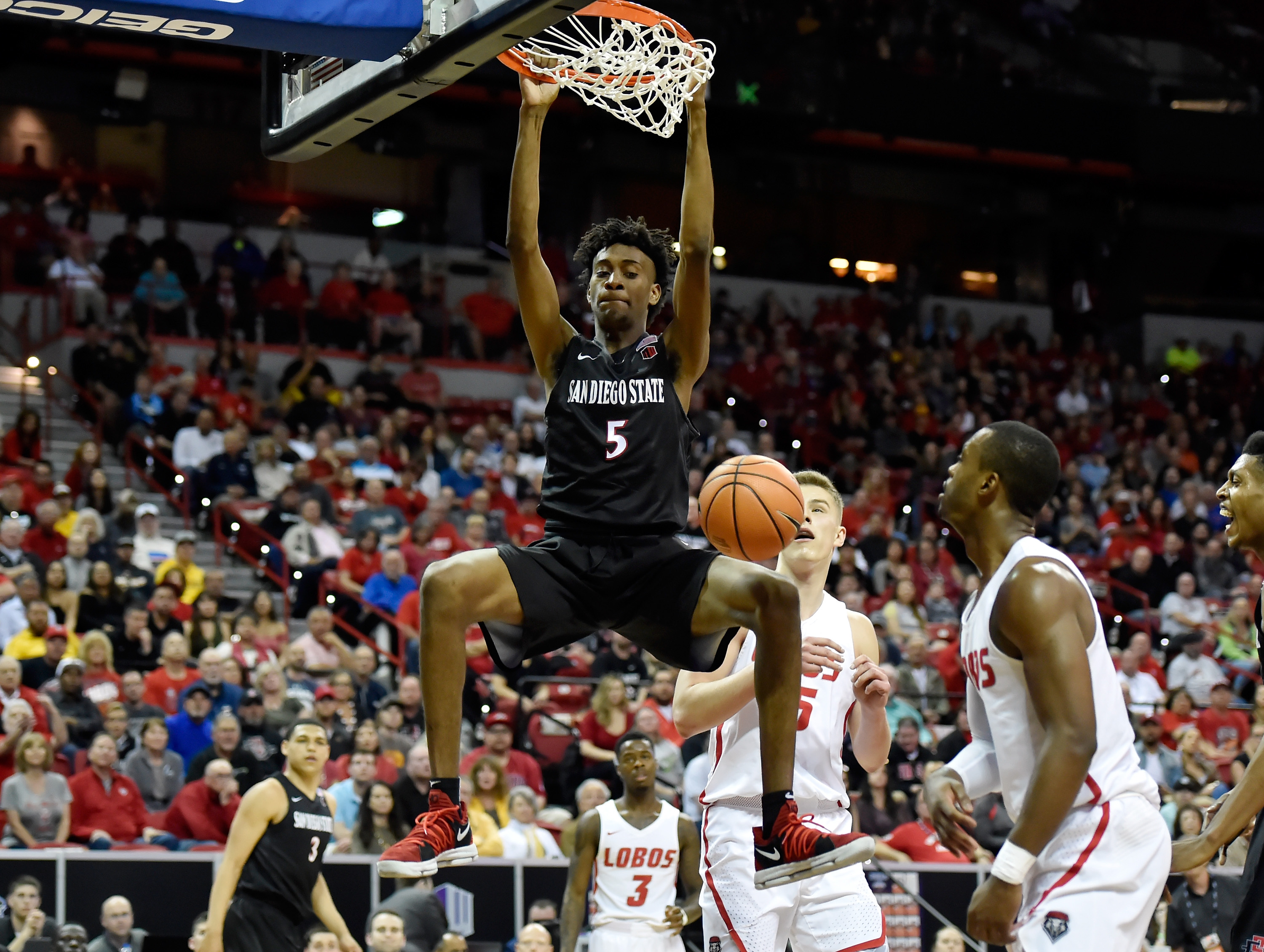 LAS VEGAS, NV - MARCH 10: Jalen McDaniels #5 of the San Diego State Aztecs ducks the ball against the New Mexico Lobos during the championship game of the Mountain West Conference basketball tournament at the Thomas & Mack Center on March 10, 2018 in Las Vegas, Nevada. (Photo by David Becker/Getty Images)
