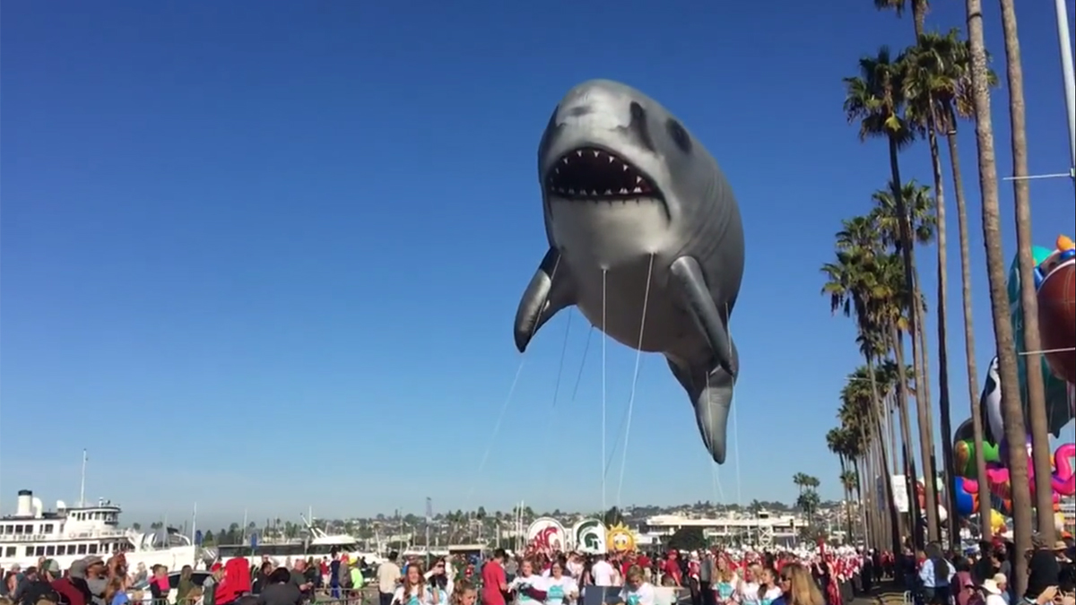 We're going to need a bigger float. A shark balloon travels the waterfront in the 2017 Holiday Bowl Parade.