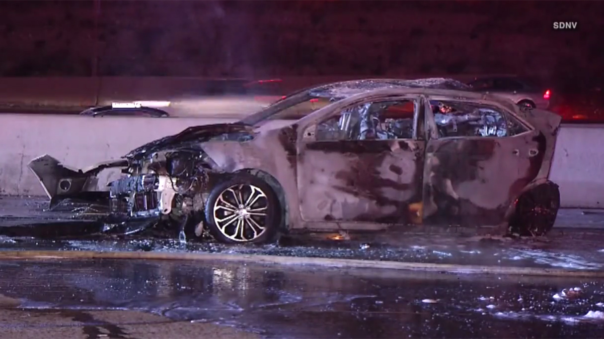 The Toyota, carrying three victims, burst into flames on the freeway after being hit twice.