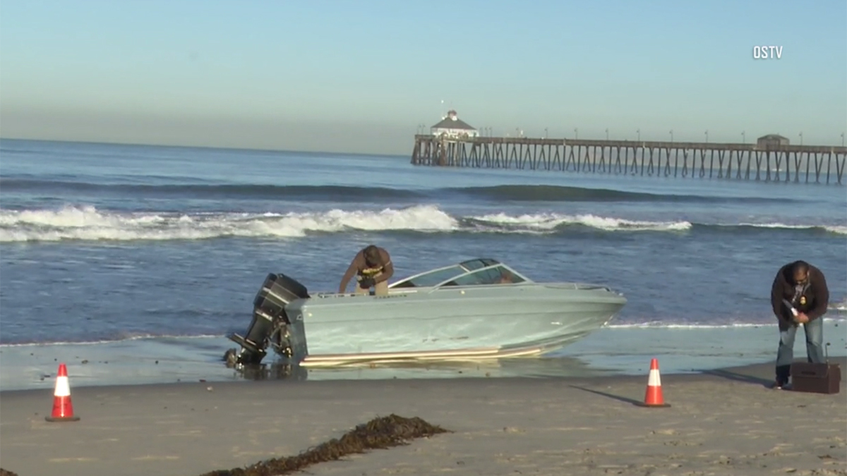 This boat, suspected of carrying undocumented immigrants, washed ashore in Imperial Beach Thursday morning.