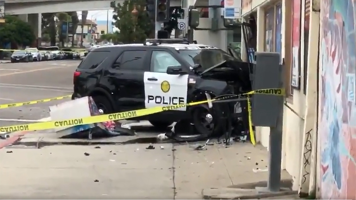 Officer, 2 Others Hurt in Crash That Sent Patrol Car Into Store