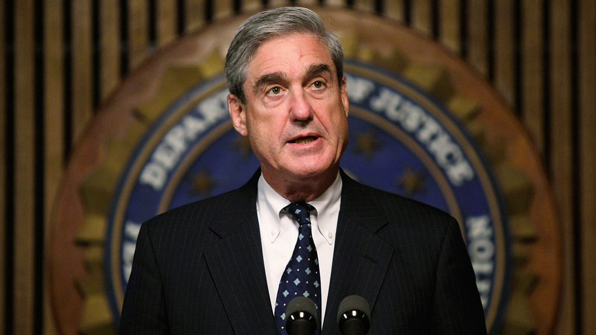 FILE - FBI Director Robert Mueller speaks during a news conference at the FBI headquarters, June 25, 2008, in Washington.