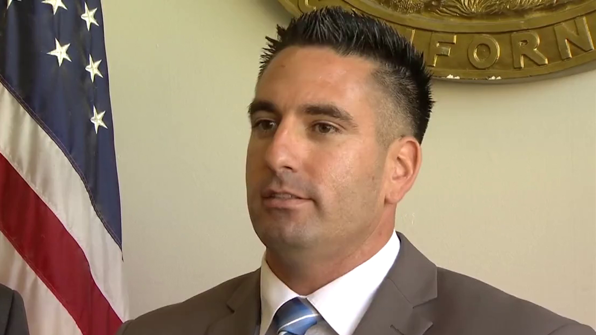 San Diego County Sheriff's Deputy Richard Fischer talks with the media following a pre-trial hearing on October 25, 2018.