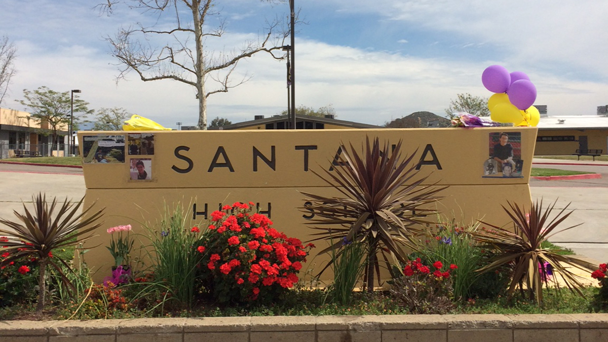 """A mini memorial of flowers, balloons and photographs was laid out at the entrance of  Santana High School Saturday to mark the 15th anniversary of the deadly shooting that shook the campus in a quiet community in San Diego's East County.On March 5, 2001, 15-year-old Santana High School freshman Charles """"Andy"""" Williams opened fire at the campus, killing two students – Brian Zuckor, 14, and Randy Gordon, 17 – and wounding 13 others."""