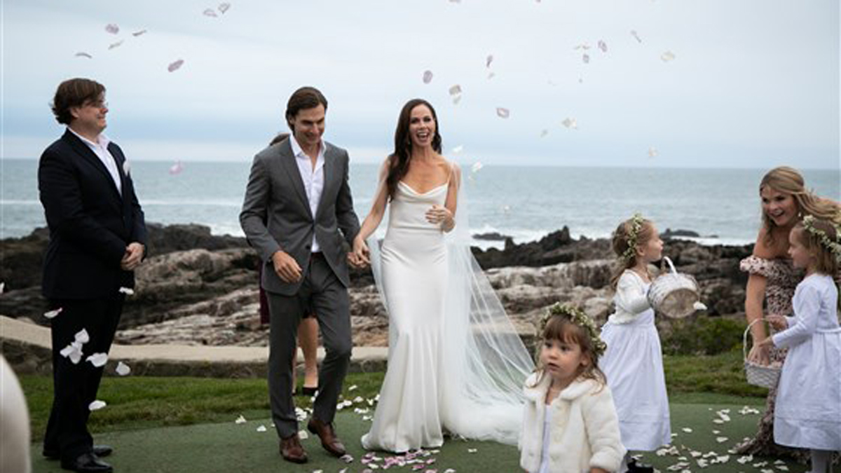 The couple surrounded by some of their younger relatives, including Poppy and Mila Hager.