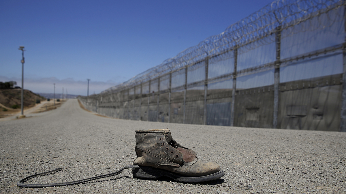 FILE - A shoe is left along a road in the enforcement zone of the U.S.-Mexico border, June 28, 2018, in San Diego.