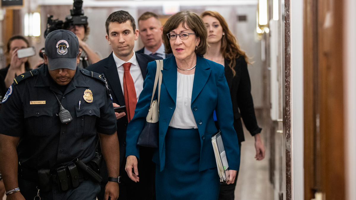 Sen. Susan Collins, R-Maine, is escorted by U.S. Capitol Police as she is met by cameras and reporters asking about embattled Supreme Court nominee Brett Kavanaugh, on Capitol Hill in Washington, Wednesday, Oct. 3, 2018. Collins was arriving to chair the Senate Special Committee on Aging.