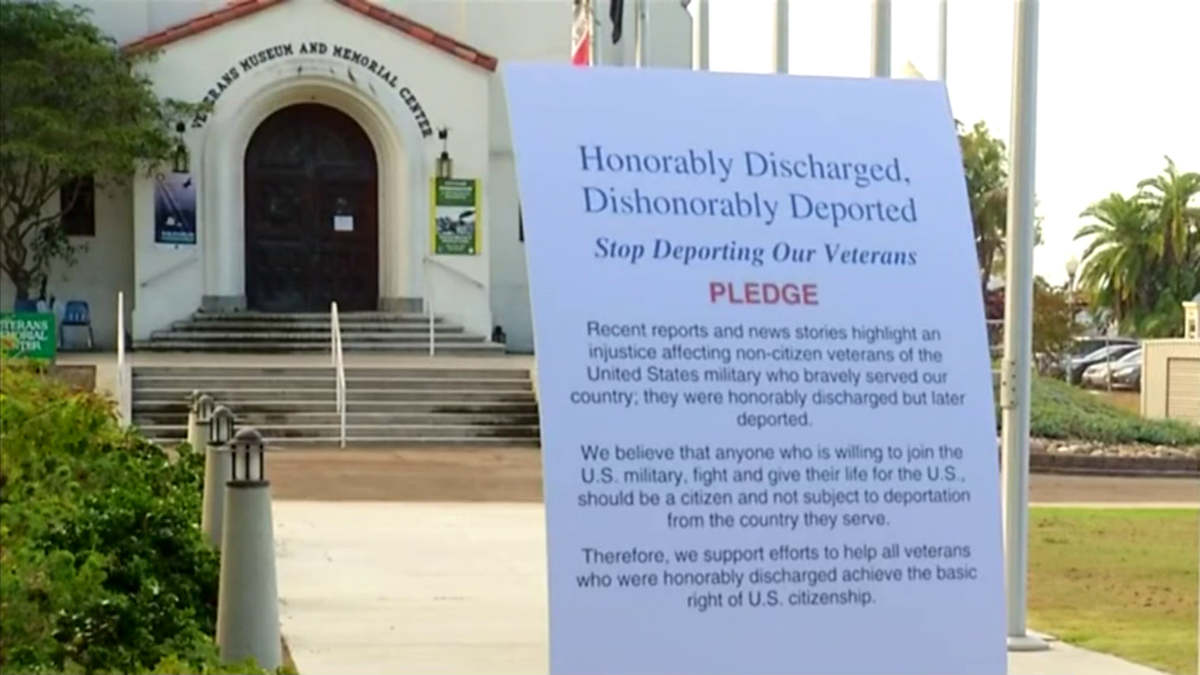 A sign pledges to support deported veterans in Balboa Park.
