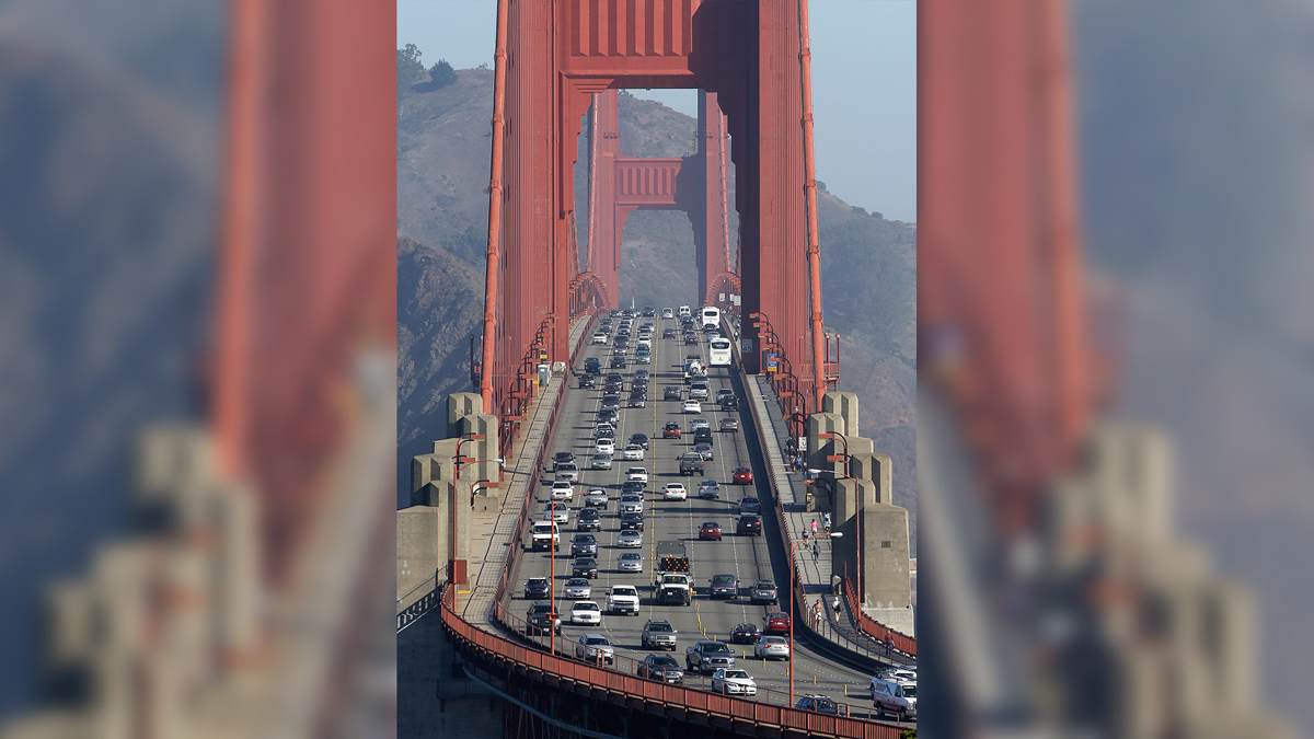 In this Sept. 19, 2013 file photo, automobile traffic flows over the Golden Gate Bridge in San Francisco. An official government environmental analysis found that President Donald Trump's weakening of pollution and fuel-efficiency standards for new cars would lead to more illnesses and deaths.
