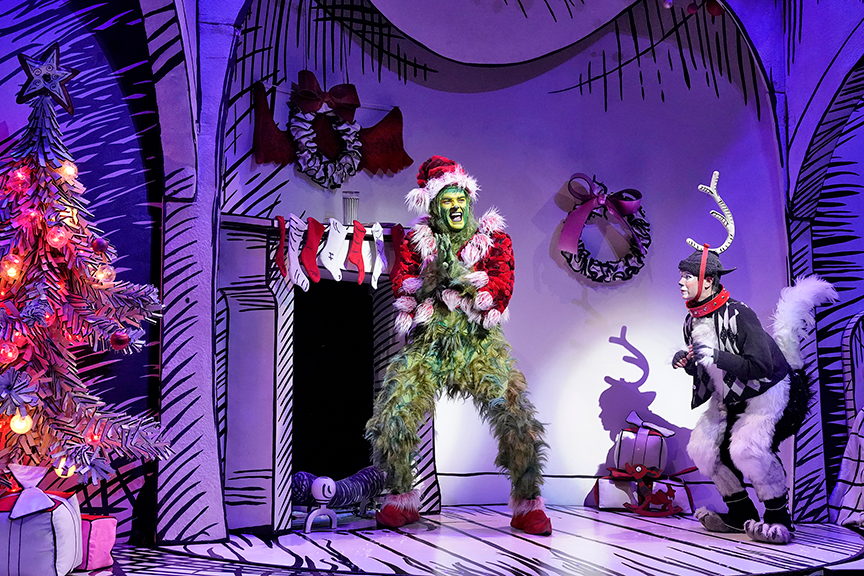 (from left) Edward Watts appears as The Grinch and Tommy Martinez as Young Max in Dr. Seuss's How the Grinch Stole Christmas!, book and lyrics by Timothy Mason, music by Mel Marvin, original production conceived and directed by Jack O'Brien, original choreography by John DeLuca, and directed by James Vásquez, running November 3 – December 29, 2018 at The Old Globe. Photo by Ken Howard.
