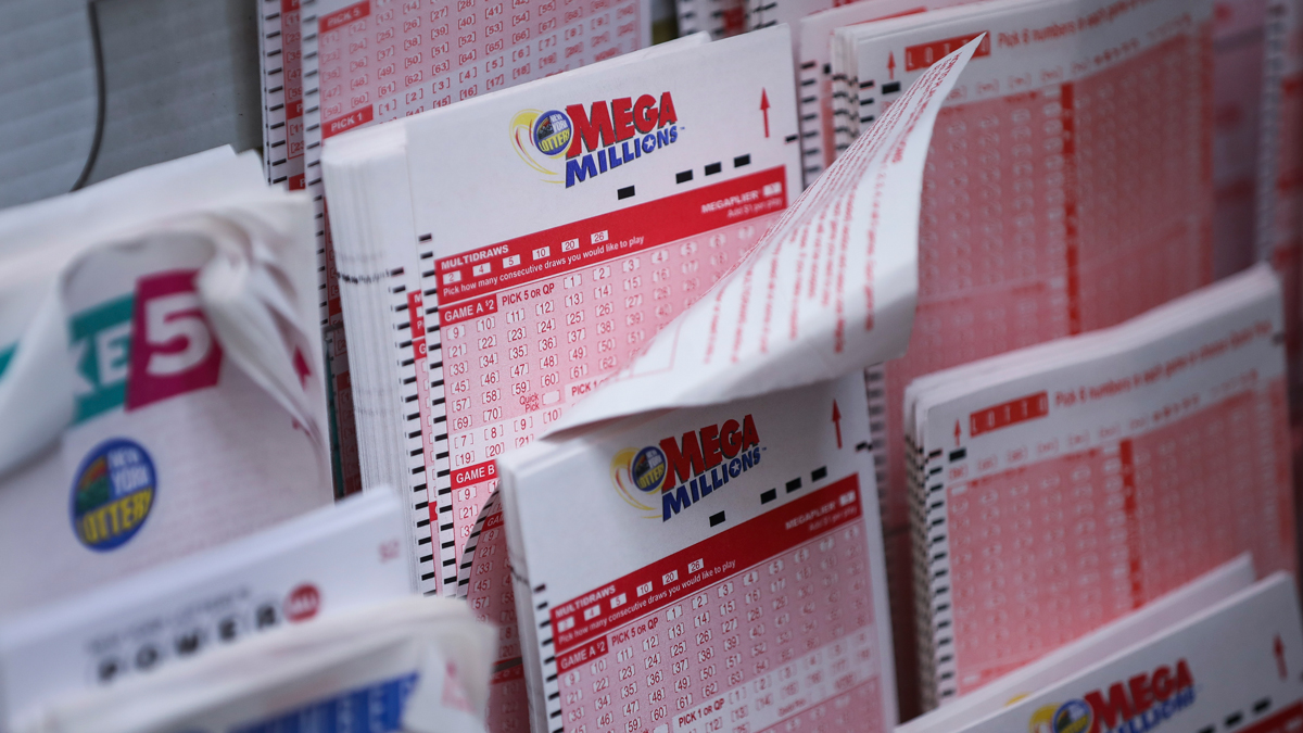 In this October 23, 2018, file photo, Mega Millions lottery tickets sit inside a convenience store in Lower Manhattan in New York City.