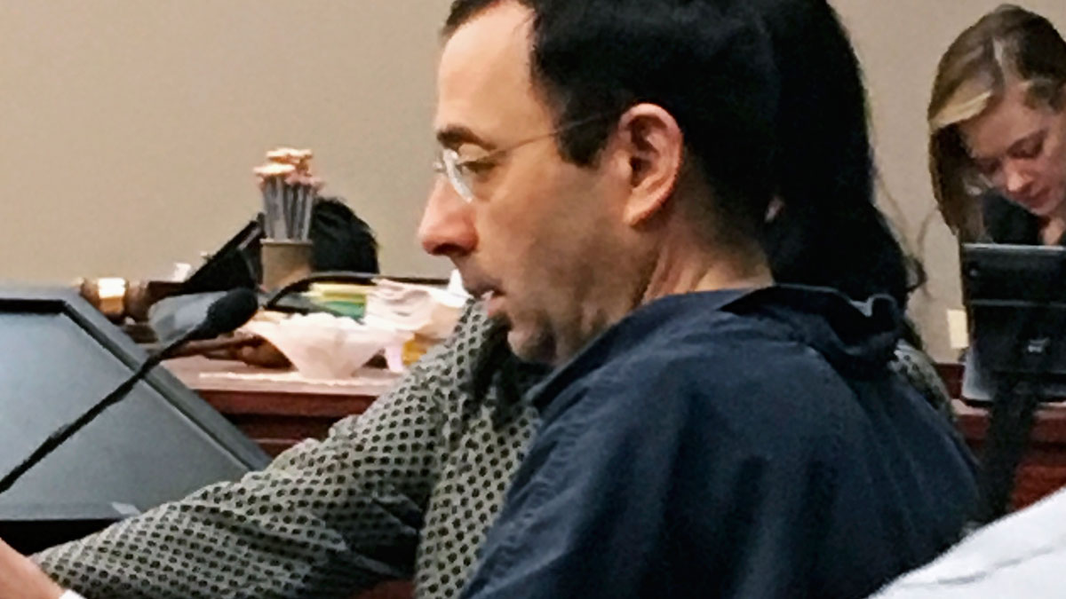 Former Michigan sports doctor Larry Nassar sits in court Tuesday, Jan. 16, 2018, in Lansing, Mich., at the start of his four-day sentencing hearing for sexually assaulting young gymnasts. Dozens of women and girls who were victims will be allowed to speak. Judge Rosemarie Aquilina is expected to order a sentence Friday, Jan. 19. (AP Photo/David Eggert)