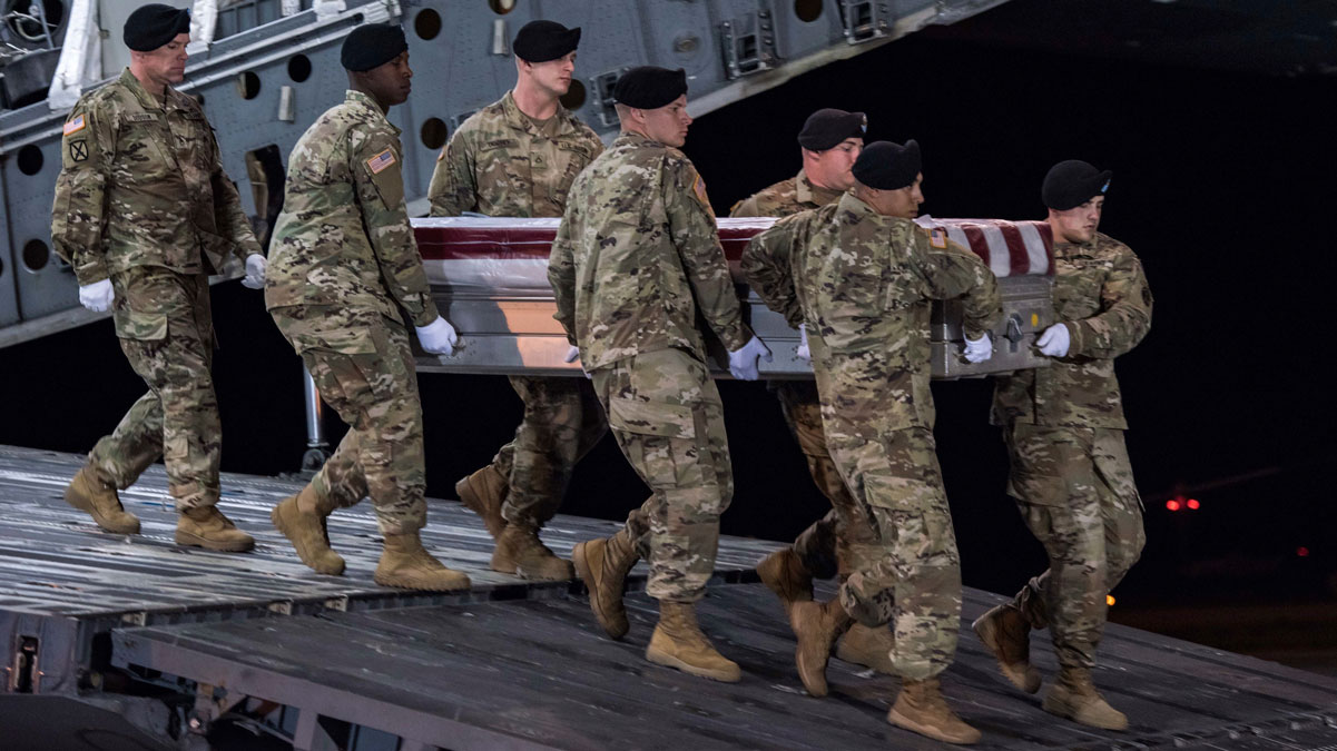 In this image provided by the U.S. Army, a carry team of soldiers from the 3d U.S. Infantry Regiment (The Old Guard), carry the transfer case during a casualty return for Staff Sgt. Dustin M. Wright, of Lyons, Ga., at Dover Air Force Base, Del., Oct. 5, 2017. U.S. and Niger forces were leaving a meeting with tribal leaders when they were ambushed on Oct. 4 and Wright and three other soldiers were killed.
