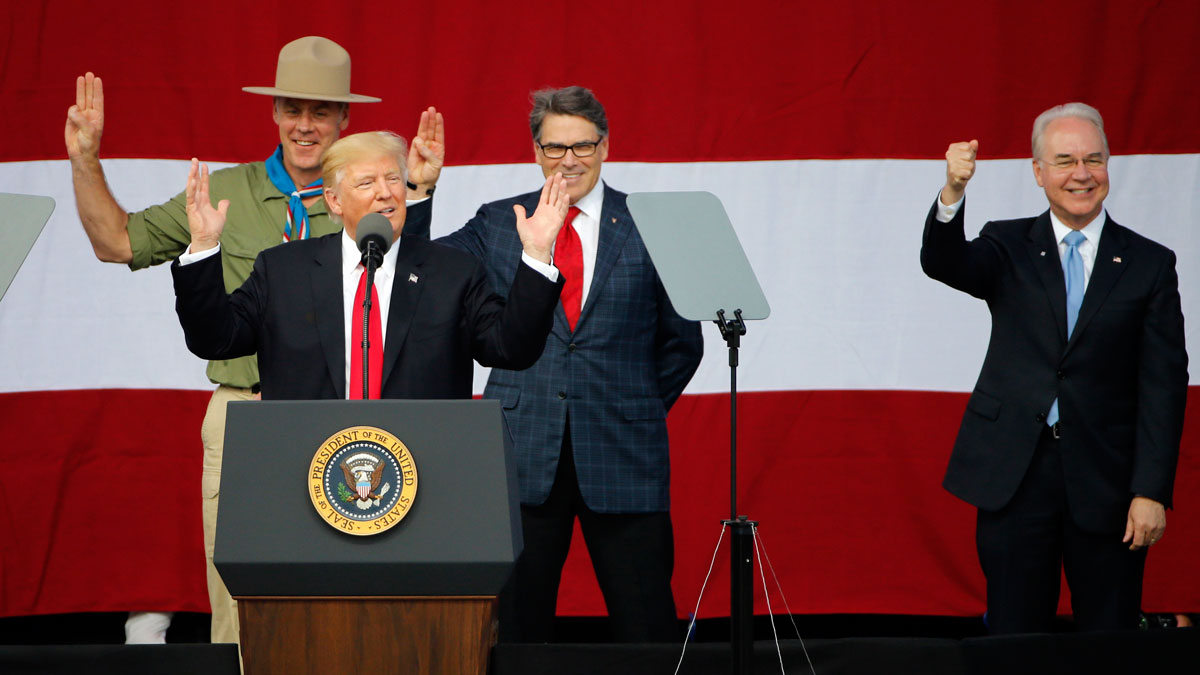 President Donald Trump, front left, gestures with former boys scouts, Interior Secretary Ryan Zinke, left, Energy Secretary Rick Perry, center, and Secretary of Health and Human Services Tom Price, right, at the 2017 National Boy Scout Jamboree at the Summit in Glen Jean, W. Va., Monday, July 24, 2017.