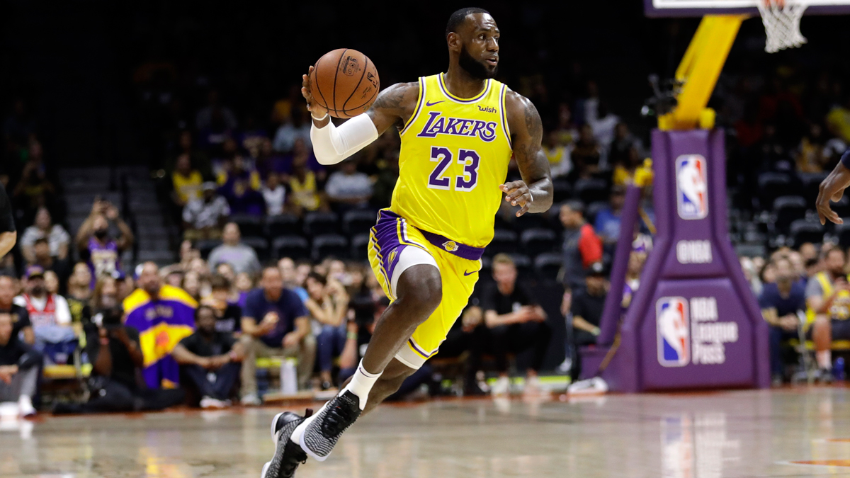 Los Angeles Lakers forward LeBron James dribbles during the first half of an NBA preseason basketball game against the Denver Nuggets, Sunday, Sept. 30, 2018, in San Diego.