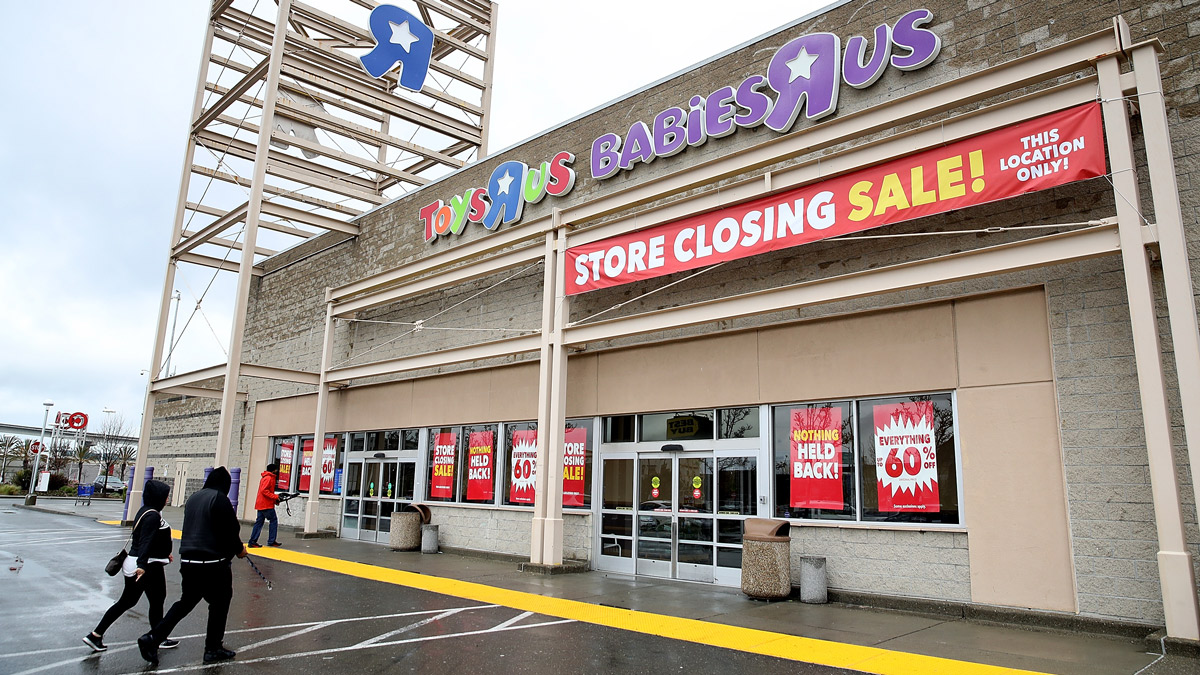 In this March 15, 2018 file photo, customers enter a Toys R Us store in Emeryville, California. Toys R Us filed for liquidation in a U.S. Bankruptcy court and plans to close 735 stores in the United States and Puerto Rico. The toy retailer will no longer accept gift cards after Saturday, April 21.