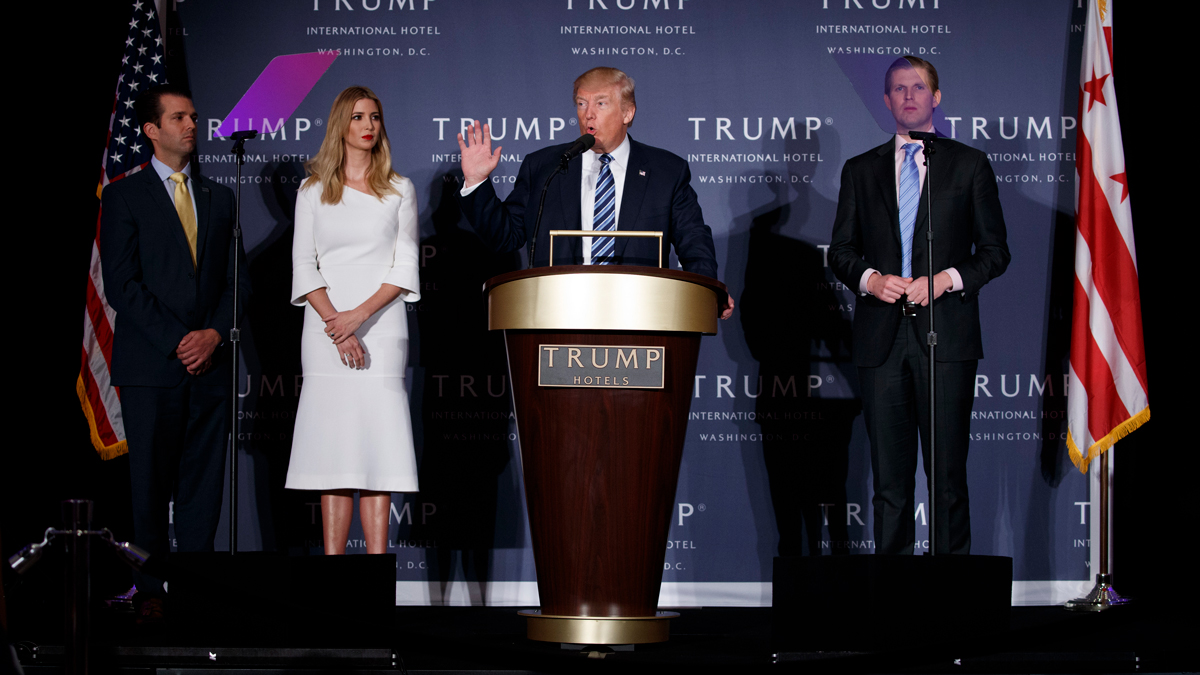 In this Wednesday, Oct. 26, 2016, file photo, then-Republican presidential candidate Donald Trump, is accompanied by, from left, Donald Trump Jr., Ivanka Trump and Eric Trump, during the grand opening of the Trump International Hotel- Old Post Office in Washington.