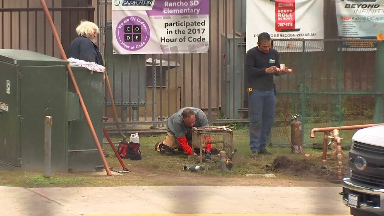District employees work on repairs outside of Rancho San Diego Elementary School.