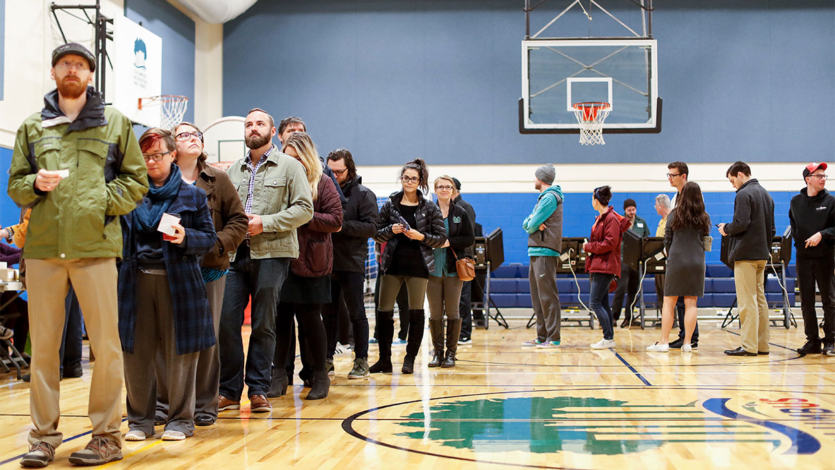 Voters prepare to cast their ballots at the Tuttle Park Recreation Center polling location, Tuesday, Nov. 6, 2018, in Columbus, Ohio.